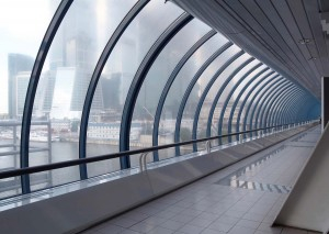 a corporate building corridor with the city in view through windows