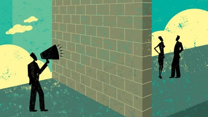 illustration of a communications breakdown with a megaphone user and a wall