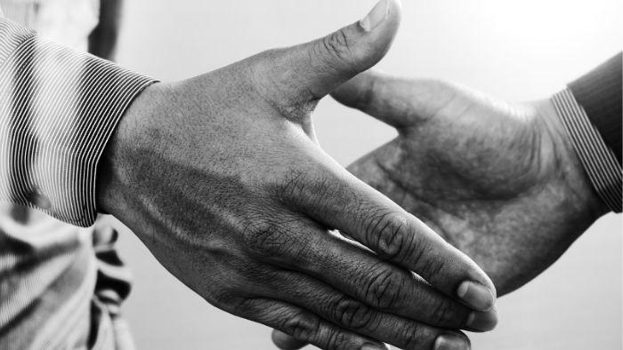 a handshake signifying trust between two people