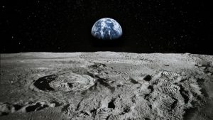 view of the Earth from the Moon's surface with astronaut footprints in the foreground