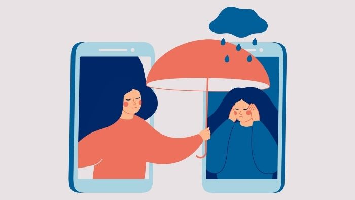 illustration of a woman comforting another via phone to suggest the need for empathy in customer communications