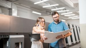 print service provider employees at work looking at printed output